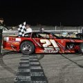 "<p>Devin brought home two wins at Showtime Speedway. He's pictured here in Victory Lane after starting eighth in the Open Wheel Modifieds feature race. In the Legends feature, Devin started third and captured the checkers. <a href=""documents/newsletters/05-15.pdf"" target=""_blank"">Click Here</a> to read more in a Club Newsletter.</p>"